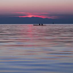 sun sea reflection clouds sunset